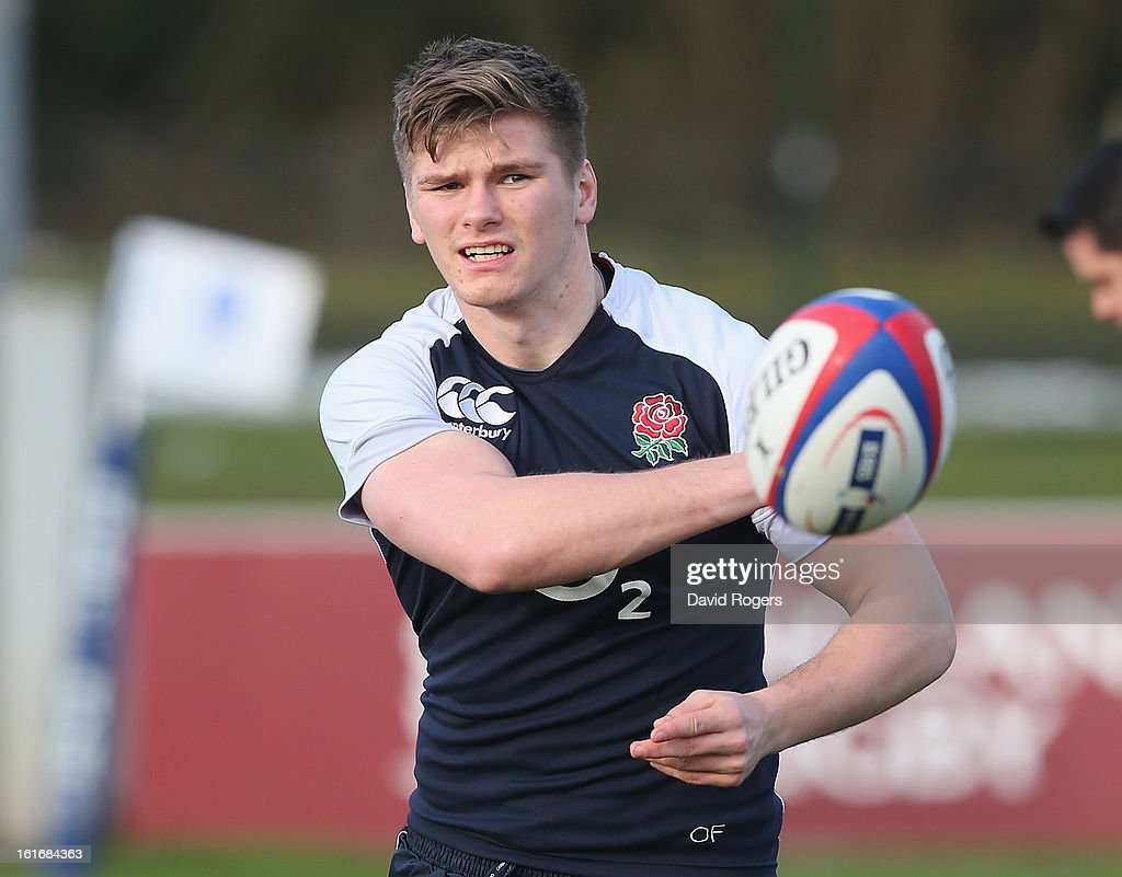 Owen Farrell passes the ball during the England training session held at St Georges Park on February 14, 2013 in Burton-upon-Trent, England.