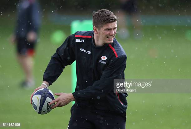 Owen Farrell passes the ball during the Saracens training session held at their training venue on October 12, 2016 in St Albans, England.