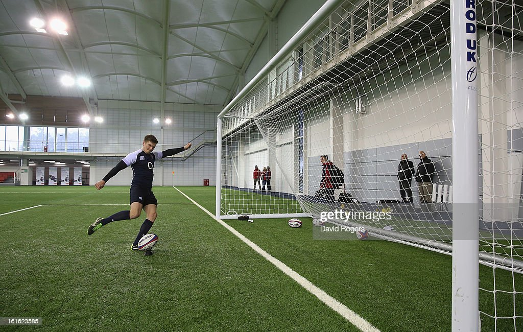 Owen Farrell practices his kicking technique during the England training session held at St Georges Park on February 13, 2013 in Burton-upon-Trent, England.