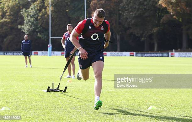 Owen Farrell pulls the weight sledge during the England training session at Pennyhill Park on September 24 2015 in Bagshot England