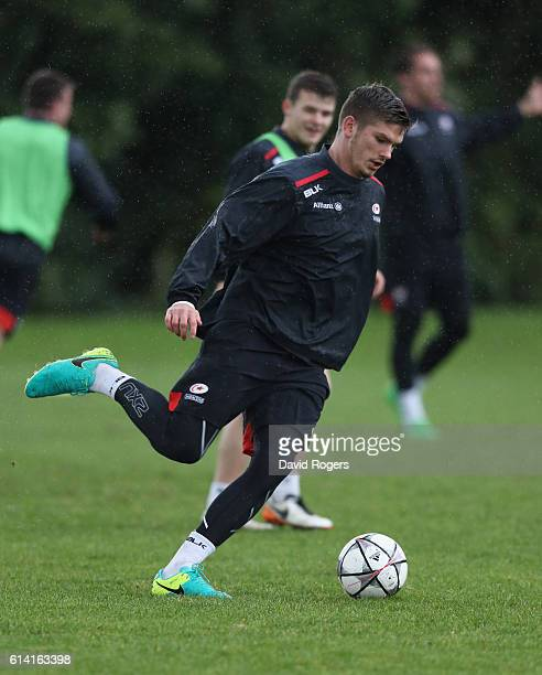 Owen Farrell runs with a soccer ball during the Saracens training session held at their training venue on October 12, 2016 in St Albans, England.