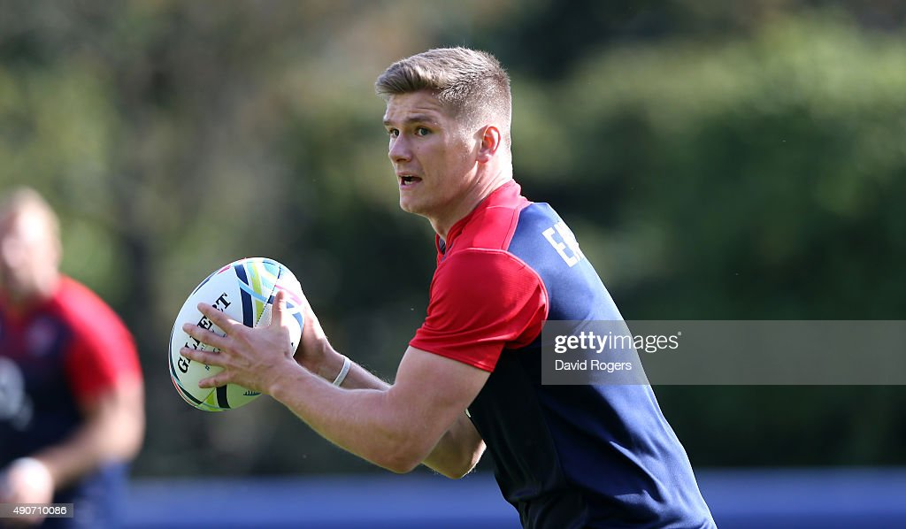 Owen Farrell runs with the ball during the England training session at Pennyhill Park on September 29, 2015 in Bagshot, England.