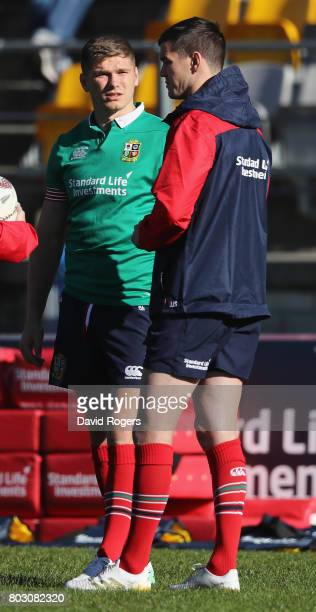 Owen Farrell talks to Jonathan Sexton during the British Irish Lions training session at Porirua Park on June 29 2017 in Wellington New Zealand