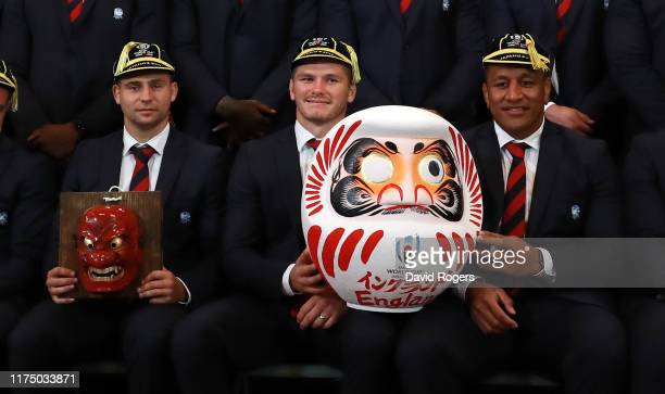 Owen Farrell the England captain holds a traditional Daruma doll with Mako Vunipola as Ben Youngs holds a Tengu mask during the England Welcome...