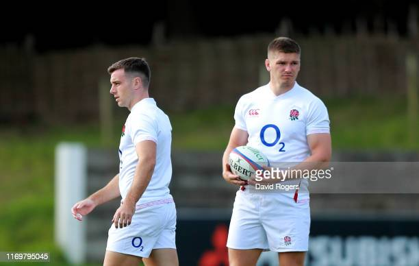 Owen Farrell the England captain looks on with team mate George Ford during the England captain's run at Pennyhill Park on August 23 2019 in Bagshot...