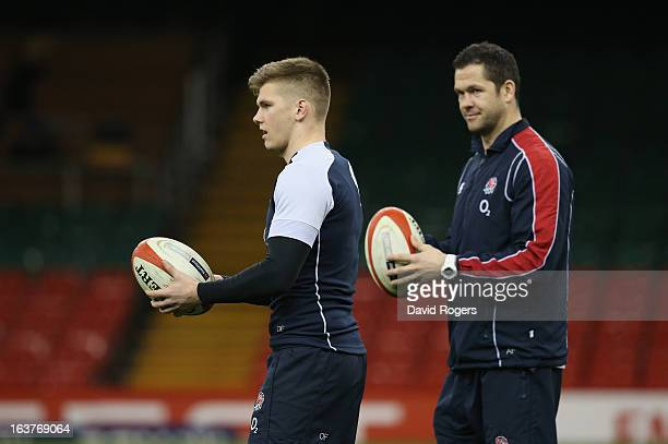 Owen Farrell the England standoff looks on with his father and England backs coach Andy Farrell during the England captain's run at the Millennium...
