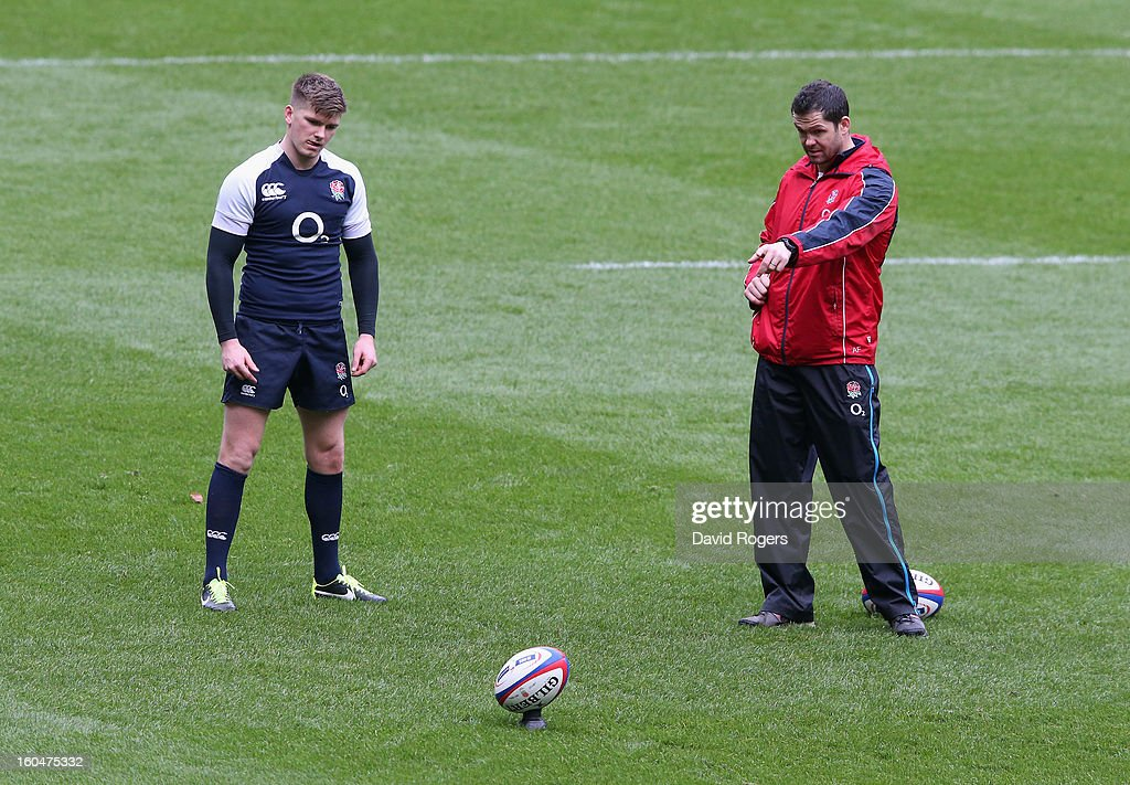 Owen Farrell, the England standoff practices his kicking watched by his father, Andy Farrell the England backs coach during the England captain's run at Twickenham Stadium on February 1, 2013 in London, England.