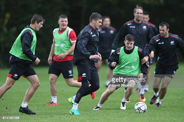 Owen Farrell, warms up with a soccer match during the Saracens training session held at their training venue on October 12, 2016 in St Albans,...