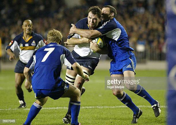 Owen Finegan tries to bust through during the Super 12 semifinal game between the Blues and the Brumbies May 17 2003 at Eden Park in Auckland New...