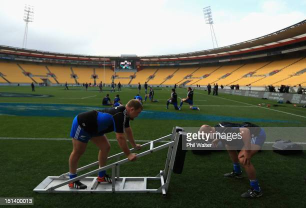 Owen Franks and Ben Franks practice the scrum during a New Zealand All Blacks captains run at Westpac Stadium on September 7 2012 in Wellington New...