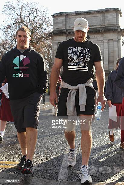 Owen Franks and Brad Thorn of the New Zealand All Blacks take a walk around the St Stephens Green shopping area on November 17 2010 in Dublin