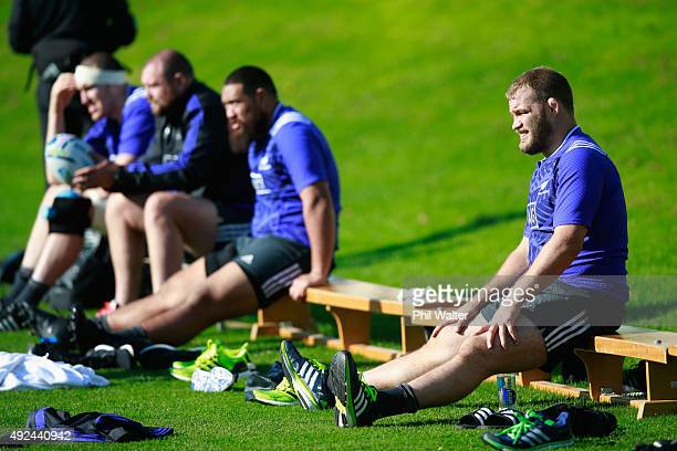 Owen Franks of the All Blacks looks on alongside Charlie Faumuina Tony Woodcock and Brodie Retallick during a New Zealand All Blacks training session...