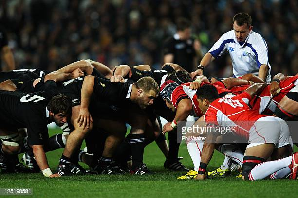 Owen Franks of the All Blacks scrummages during the IRB 2011 Rugby World Cup Pool A match between New Zealand and Japan at Waikato Stadium on...
