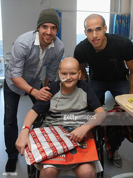 Owen Hargreaves and Gabriel Obertan of Manchester United pose with Jonathan Salisbury from Blackpool at the Royal Manchester Children's Hospital as...
