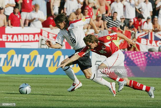 Owen Hargreaves of England evades Daniel Gygax of Switzerland during the UEFA Euro 2004 Group B match between England and Switzerland on June 17,...