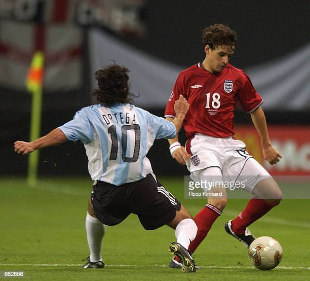 Owen Hargreaves of England goes past Ariel Ortega of Argentina during the FIFA World Cup Finals 2002 Group F match played at the Sapporo Dome in...