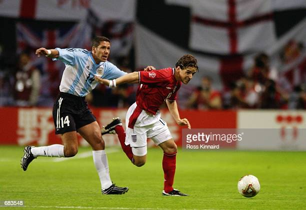 Owen Hargreaves of England is closed down by Diego Simeone of Argentina during the England v Argentina Group F World Cup Group Stage match played at...