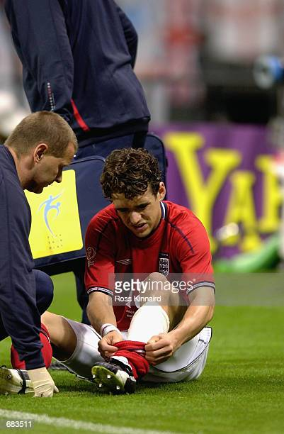 Owen Hargreaves of England looks at the extent of the injury he recieved during the Group F match against Argentina at the World Cup Group Stage...