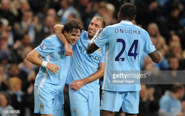 Owen Hargreaves of Manchester City celebrates scoring to make it 10 with Pablo Zabaleta during the Carling Cup Third Round match between Manchester...