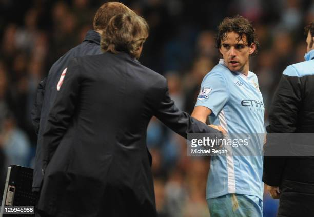 Owen Hargreaves of Manchester City is subbed by manager Roberto Mancini during the Carling Cup Third Round match between Manchester City and...