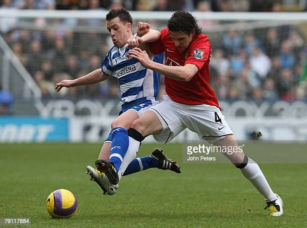 Owen Hargreaves of Manchester United clashes with Nicky Shorey of Reading during the Barclays FA Premier League match between Reading and Manchester...