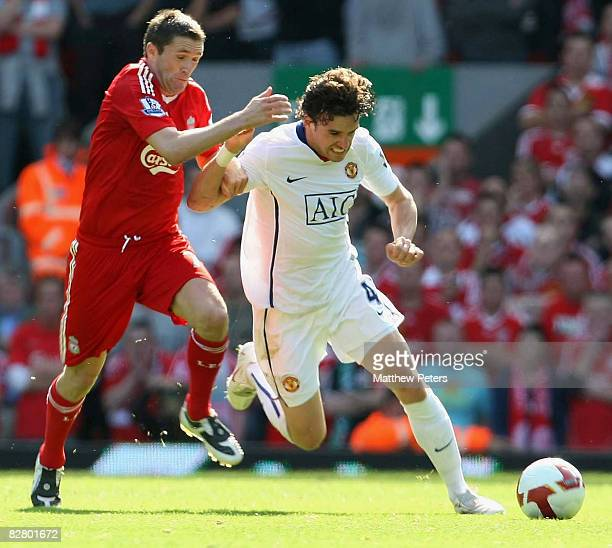 Owen Hargreaves of Manchester United clashes with Robbie Keane of Liverpool during the FA Premier League match between Liverpool and Manchester...