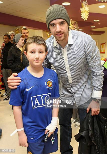 Owen Hargreaves of Manchester United poses with Lukas McKeown from Swinton at the Royal Manchester Children's Hospital as part of the club's annual...