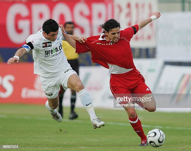 Owen Hargreaves of Munich challenges for the ball with Blerim Dzemaili of Zuerich during the friendly match between Bayern Munich and FC Zuerich at...