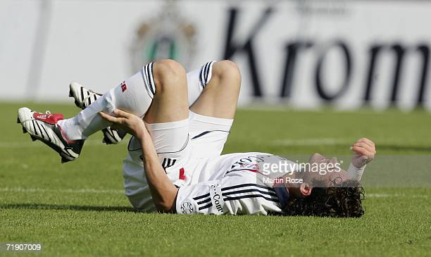 Owen Hargreaves of Munich is injured after a foul during the Bundesliga match between Arminia Bielefeld and Bayern Munich at the Schuco Arena on...
