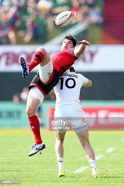 Owen Jenkins of Wales jumps for the ball against Ruaridh McConnochie of England during the Emirates Dubai Rugby Sevens HSBC Sevens World Series at...