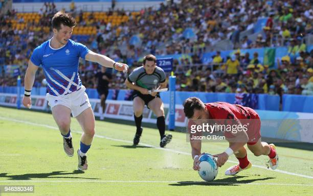 Owen Jenkins of Wales scores a try against Scotland during Rugby Sevens on day 11 of the Gold Coast 2018 Commonwealth Games at Robina Stadium on...