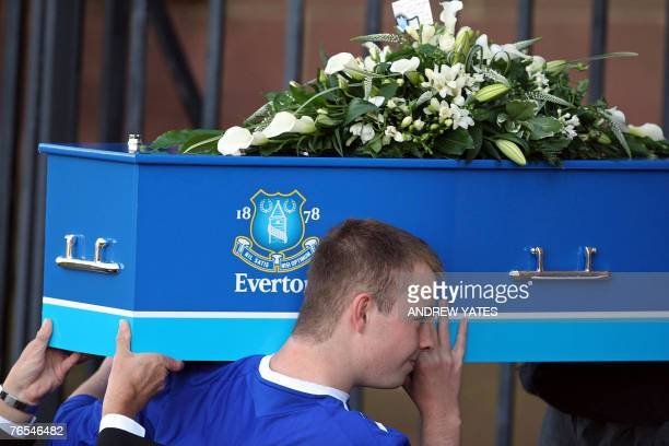 Owen Jones the brother of murdered school boy Rhys Jones helps to carry his coffin into the Liverpool Anglican Cathedral in Liverpool northwest...