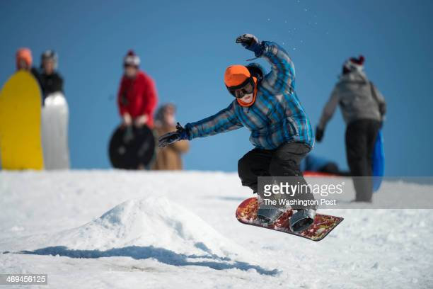 Owen Kane is ejected into the air by a snow hump on Reidel Hill in Crofton Maryland on February 14 2014 Riedel Hill is a popular sledding location in...
