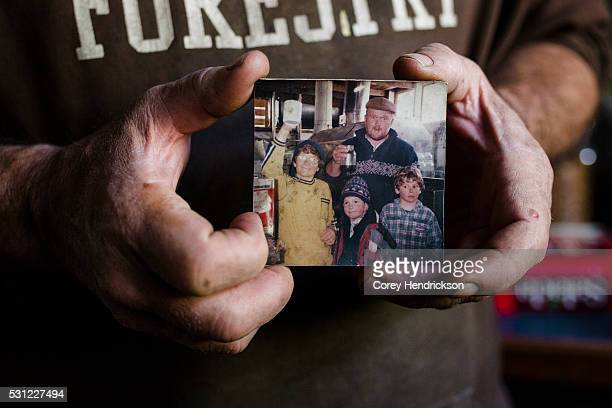 Owen Labrie supporter Marc McKee holding an old photograph taken with Owen while maple sugaring November 9 2015 in Vershire Vermont