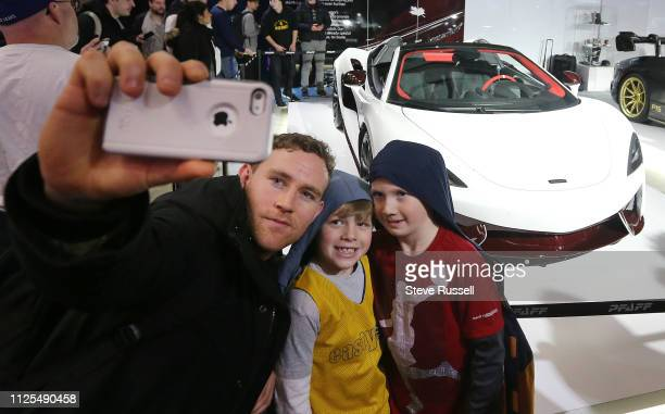 TORONTO ON FEBRUARY 16 Owen Lally takes a selfie with his sons Simon and Gavin in front of a McLaren 570S Spider at the 2019 Canadian International...