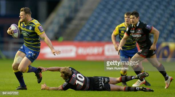 Owen Lane of Cardiff Blues is tackled by Jaco van der Walt of Edinburgh during the European Rugby Challenge Cup match between Edinburgh and Cardiff...