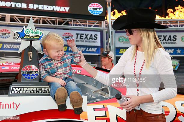 Owen Larson the son of Kyle Larson driver of the ENEOS Chevrolet celebrates in Victory Lane with his mom Katelyn Sweet after the NASCAR XFINITY...