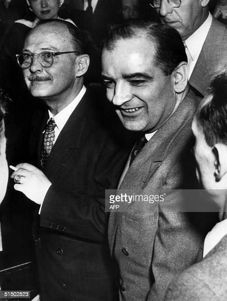 Owen Lattimore passes Senator Joseph McCarthy after ex-Communist Louis F. Budenzho called him a member of a Communist spy cell in testimony before...