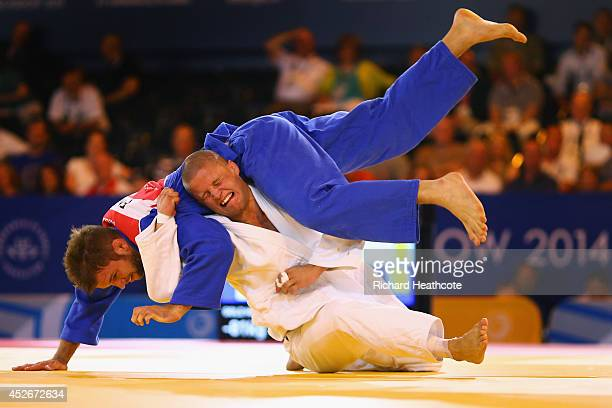 Owen Livesey of England competes with Tom Reed of England in the Men's 81kg judo final at SECC Precinct during day two of the Glasgow 2014...
