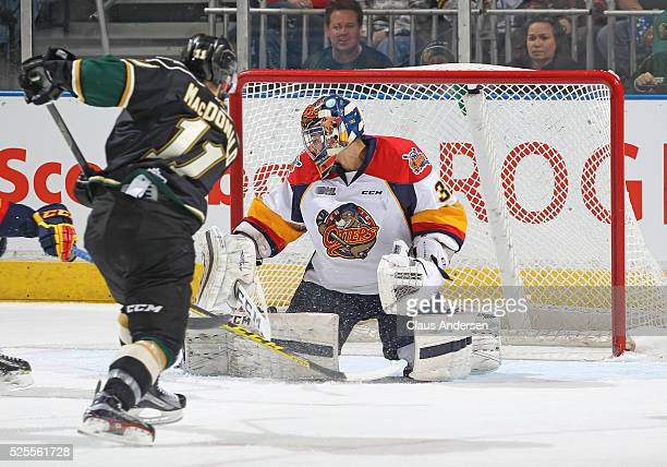 Owen MacDonald of the London Knights fires a puck past Devin Williams of the Erie Otters during game four of the OHL Western Conference Final on...