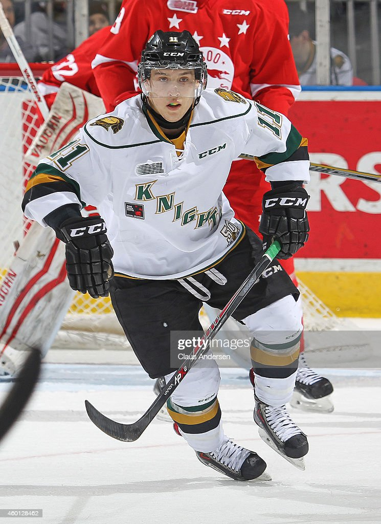 Owen MacDonald #11 of the London Knights skates against the Sault Ste. Marie Greyhounds in an OHL game at Budweiser Gardens on December 5, 2014 in London, Ontario, Canada. The Greyhounds defeated the Knights 4-0.