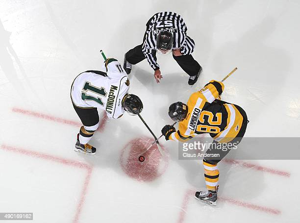 Owen MacDonald of the London Knights takes a faceoff against Juho Lammikko of the Kingston Frontenacs during an OHL game at Budweiser Gardens on...