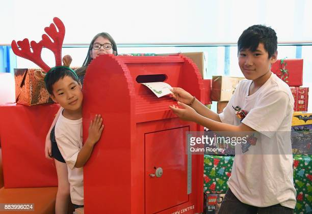 Owen Mackiggan post a letter in a letterbox made out of LEGO at Chadstone Shopping Centre on December 2 2017 in Melbourne Australia The special...