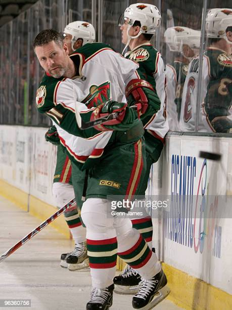 Owen Nolan of the Minnesota Wild fires some pucks around the boards during warm ups against the Dallas Stars on February 2 2010 at the American...