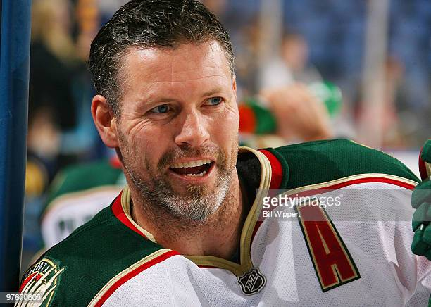 Owen Nolan of the Minnesota Wild gets in some conversation while warming up to play the Buffalo Sabres on March 12 2010 at HSBC Arena in Buffalo New...