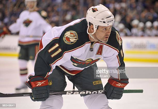Owen Nolan of the Minnesota Wild gets ready for a faceoff during the NHL game against the Vancouver Canucks on April 04 2010 at General Motors Place...
