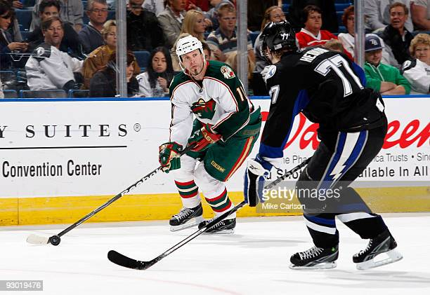 Owen Nolan of the Minnesota Wild passes the puck against Victor Hedman of the Tampa Bay Lightning at the St Pete Times Forum on November 12 2009 in...