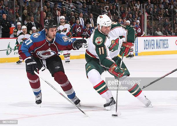 Owen Nolan of the Minnesota Wild skates against Kyle Quincey of the Colorado Avalanche at the Pepsi Center on January 28 2010 in Denver Colorado