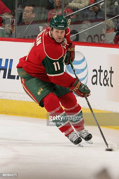 Owen Nolan of the Minnesota Wild skates with the puck against the Anaheim Ducks during the game at the Xcel Energy Center on October 6 2009 in Saint...