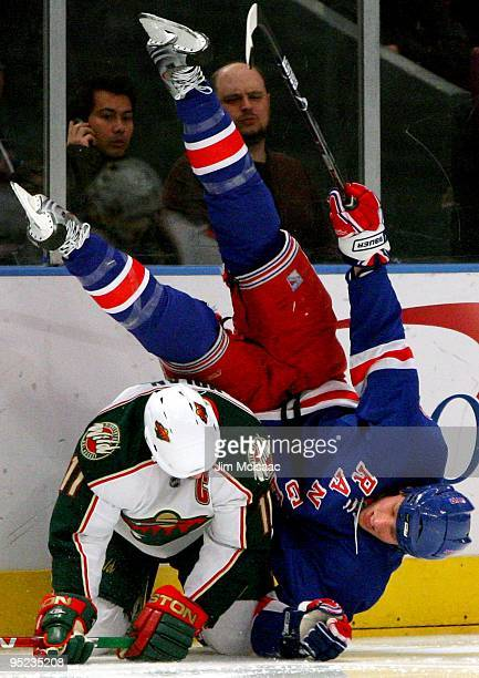 Owen Nolan of the Minnesota Wild upends Marc Staal of the New York Rangers at Madison Square Garden March 24 2009 in New York City